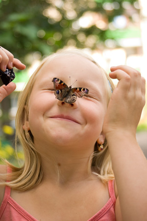 Girl with butterfly on nose
