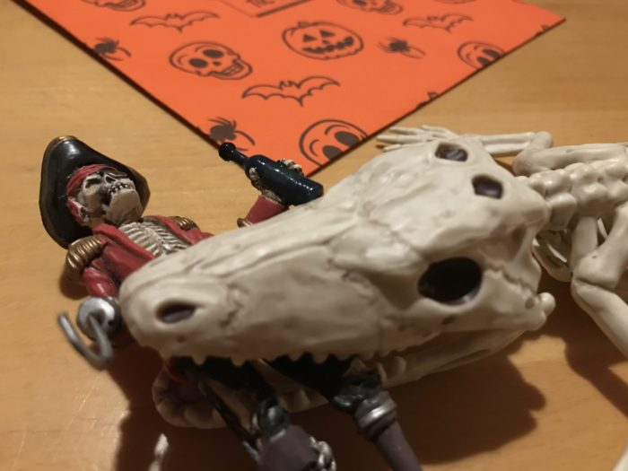 undead alligator eating a zombie pirate