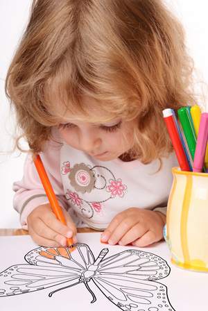 Little girl coloring butterfly printable.